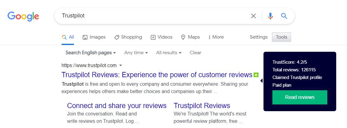 Zoekresultaten van Google waarbij de Google Chrome-extensie van Trustpilot is ingeschakeld
